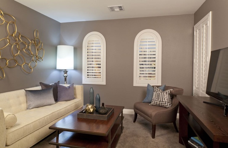 Detroit family room with rounded plantation shutters.