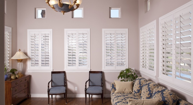 Chic parlor with classic shutters
