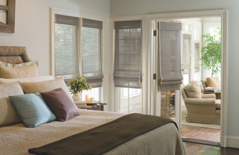 Woven shades on bedroom windows