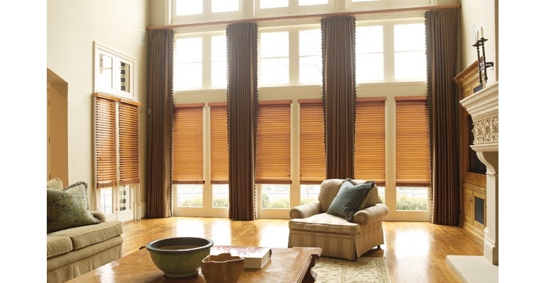 Detroit great room with natural wood blinds and floor to ceiling draperies.