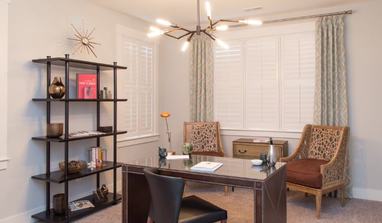 Detroit home office with plantation shutters.