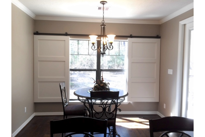 Detroit dining room with white barn door shutters.