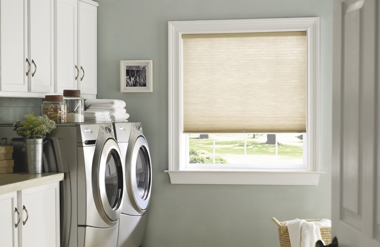 Detroit laundry room with beige window shades.