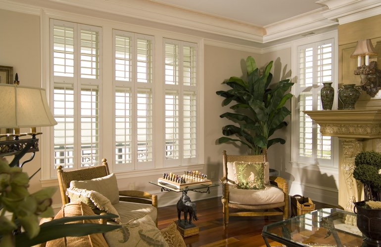 Living Room in Detroit with white plantation shutters.