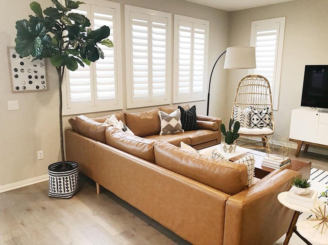 Cozy living room with Polywood shutters in Detroit.