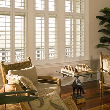 Detroit living room polywood shutters.