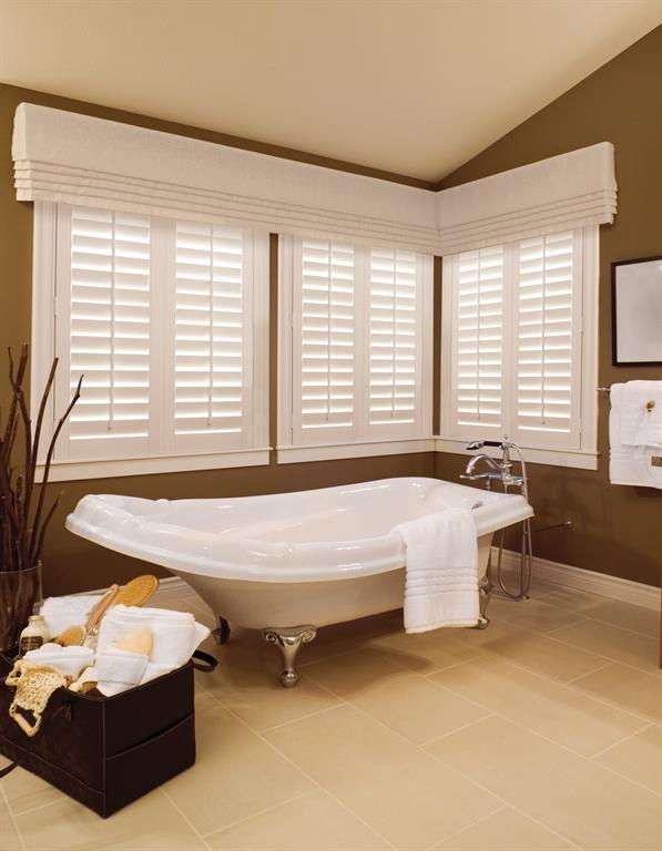 Plantation shutters stand out against a brown bathroom wall