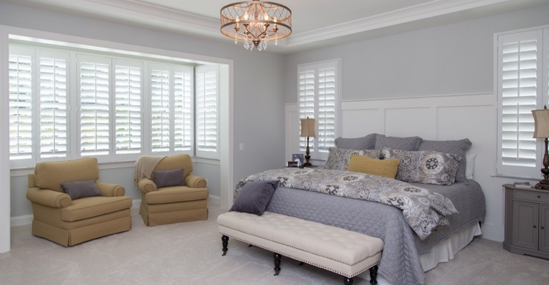 Plantation shutters in Detroit bedroom.