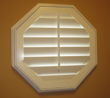 Detroit octagon window with white shutter