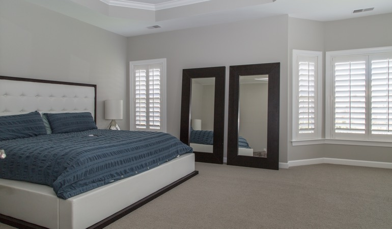 Polywood shutters in a minimalist bedroom in Detroit.
