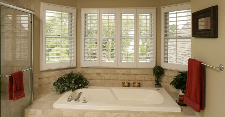 Plantation shutters in Detroit bathroom.