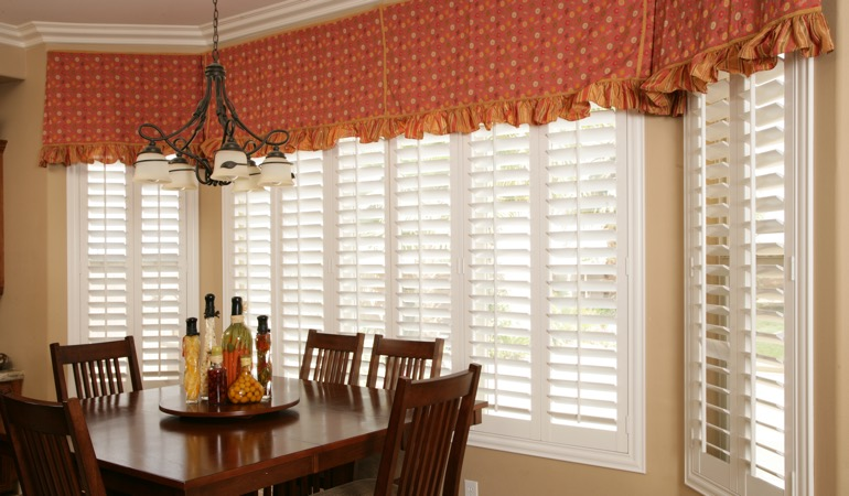 Plantation shutters in Detroit dining room.