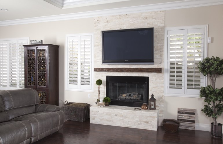 White plantation shutters in a Detroit living room with solid hardwood floors.