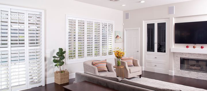 Detroit living room in white with plantation shutters.