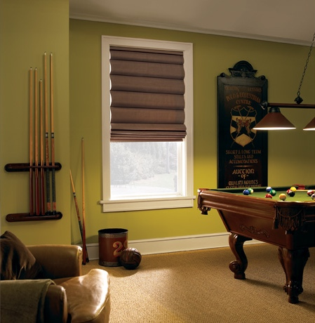 Roman shades in Detroit pool room with green walls.