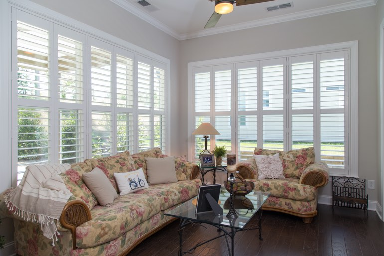 Airy sunroom with plantation shutters in Detroit.