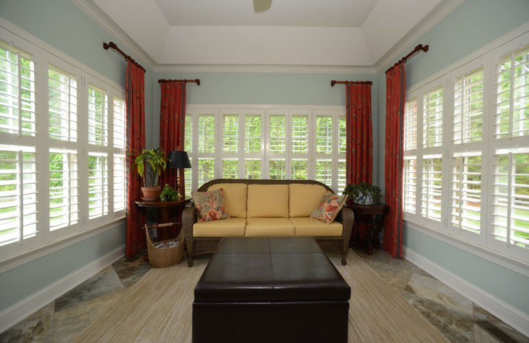 Detroit sunroom with classic window shutters.