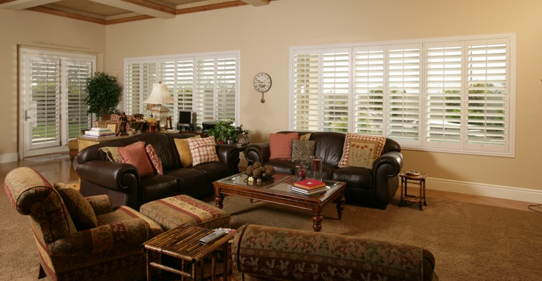 Detroit sunroom with white shutters.