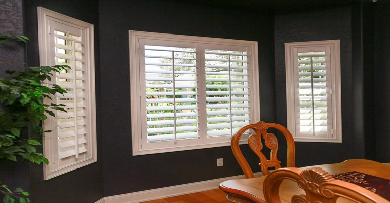 Beautiful Plantation Shutters In Dark Green Dining Room