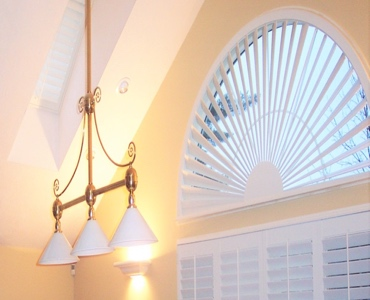 Detroit arched eyebrow window with custom shutter