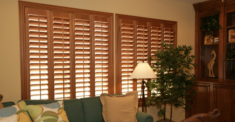 Wood shutters in Detroit living room.
