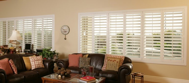 Wide window with plantation shutters in Detroit living room